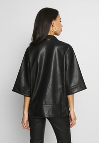 Monki - DALE BLOUSE - Button-down blouse - black - 2