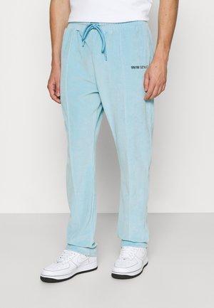 TRACK PANTS UNISEX - Pantalon de survêtement - skyblue