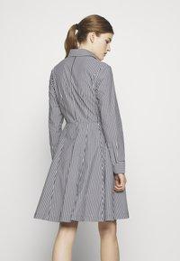 Steffen Schraut - EXCLUSIVE BLOUSE DRESS - Shirt dress - black/white - 2