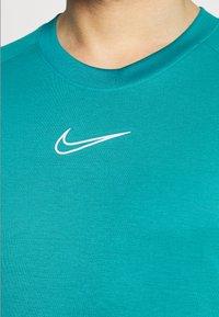 Nike Performance - DRY - T-shirt con stampa - aquamarine/white - 5