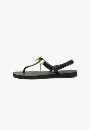 BEATRIX - T-bar sandals - black