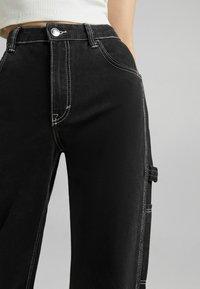 Bershka - Flared Jeans - dark grey - 3