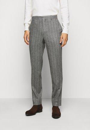 LEO HERRINGBONE  - Suit trousers - black
