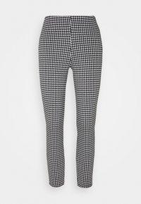 NMHOUND LEGGING - Trousers - black/white