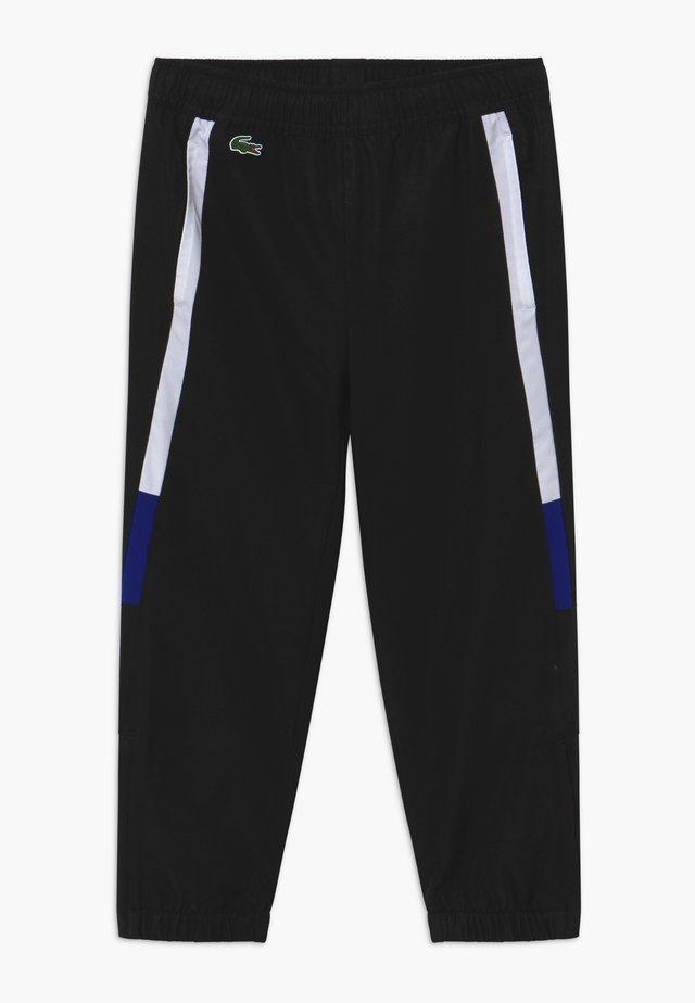 TENNIS PANT - Teplákové kalhoty - black/white cosmic