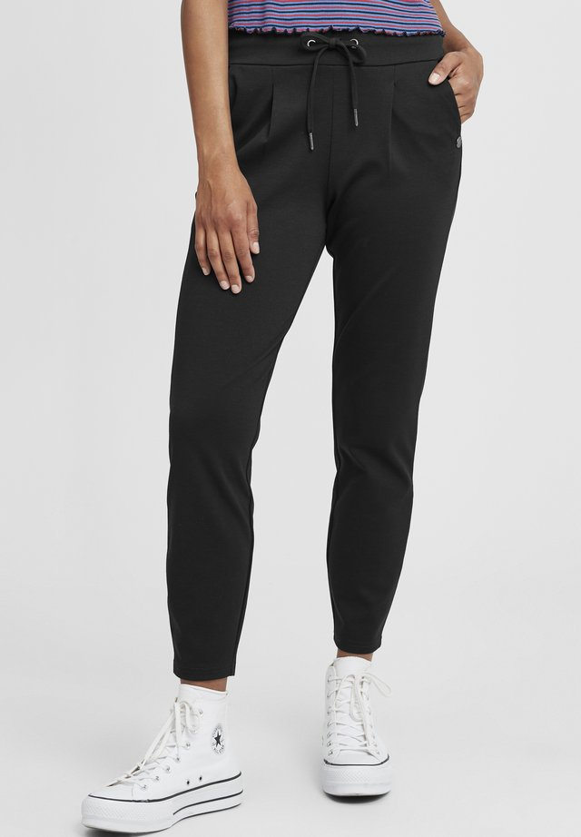 ANITA - Trousers - black