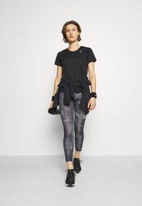 Nike Performance - RACE - Basic T-shirt - black/silver - 1