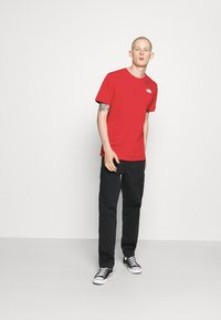 The North Face - MESSAGE TEE - T-shirt con stampa - red - 1
