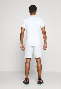 Nike Performance - FLX ACE - Sports shorts - white/black - 2