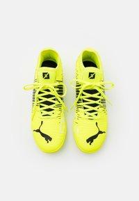 Puma - FUTURE Z 4.1 TT - Astro turf trainers - yellow alert/black/white - 3