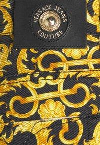 Versace Jeans Couture - TUPO - Slim fit jeans - black - 7