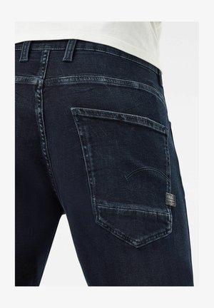 MOTAC 3D SLIM - Slim fit jeans - worn in eve destroyed