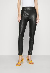 ONLY - ONLJESSIE - Leggings - Trousers - black - 0