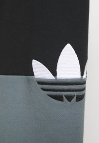 adidas Originals - SLICE - Tracksuit bottoms - black/blue oxide - 5