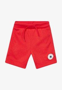 Converse - PRINTED CHUCK PATCH - Pantalon de survêtement - university red - 2