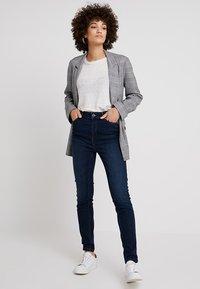 comma - Slim fit jeans - blue denim - 1