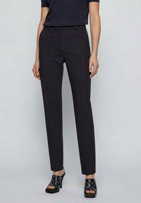 BOSS - Trousers - open blue - 0