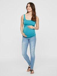 MAMALICIOUS - Slim fit jeans - light blue denim - 1