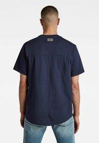 G-Star - C&S BACK MULTI GRAPHIC LOOSE - Print T-shirt - warm sartho - 1