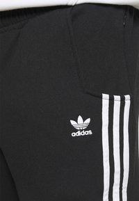 adidas Originals - NINJA PANT UNISEX - Tracksuit bottoms - black - 3
