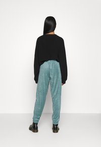 Topshop - TOWLLING JOGGER - Tracksuit bottoms - ice blue - 2