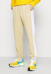 Nike Sportswear - Tracksuit bottoms - grain/white/coconut milk - 0