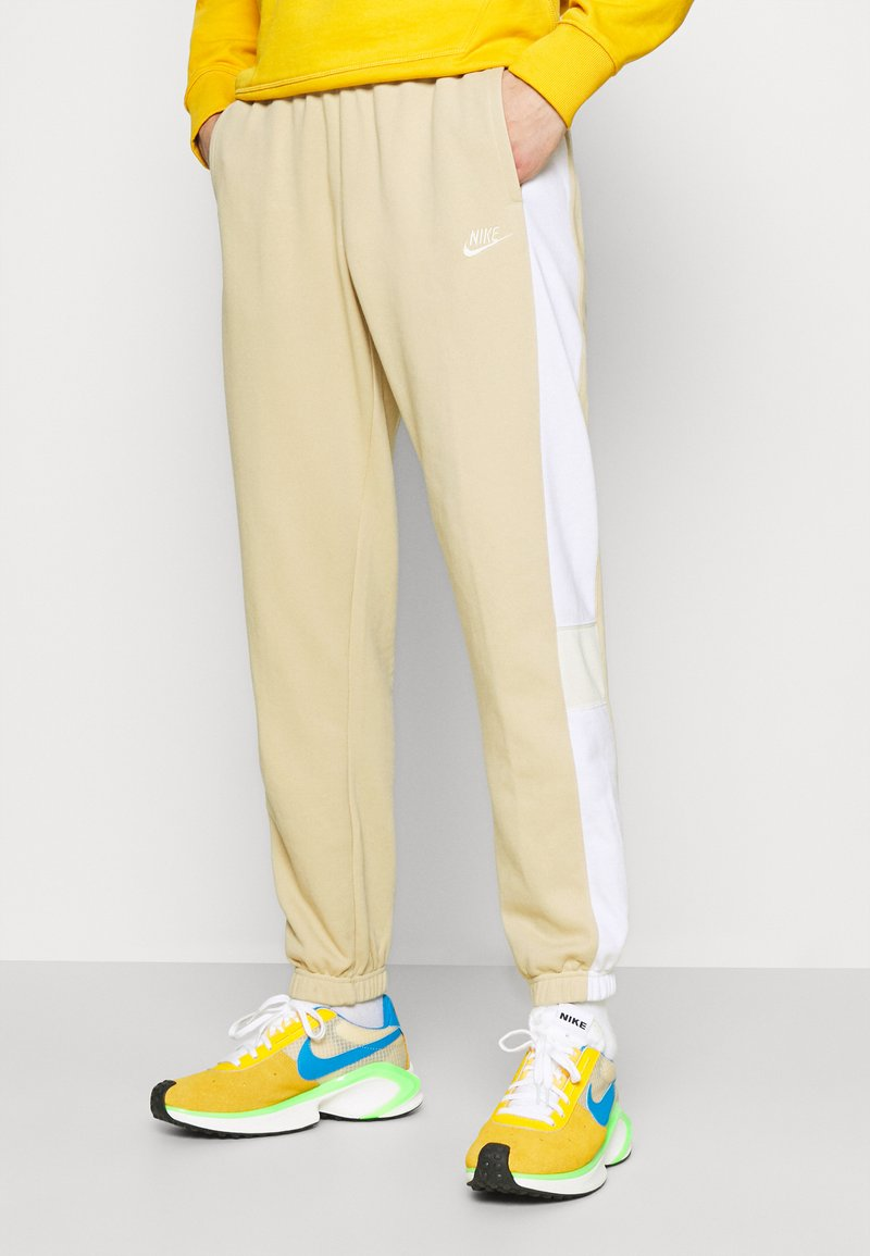 Nike Sportswear - Tracksuit bottoms - grain/white/coconut milk