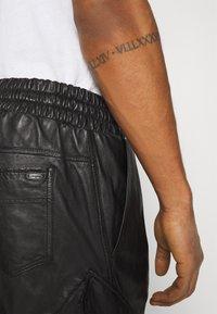 Tigha - TANO - Leather trousers - black - 4