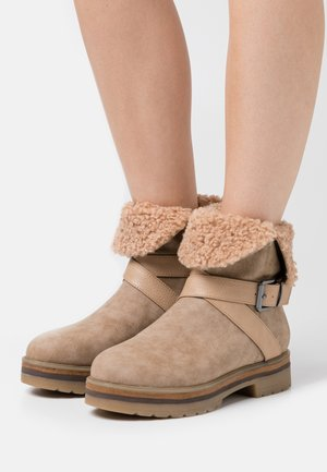 Bottines à plateau - beige
