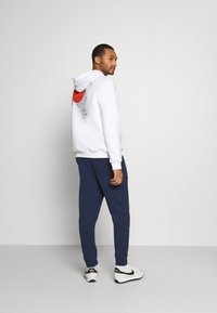 Nike Sportswear - MODERN  - Tracksuit bottoms - midnight navy