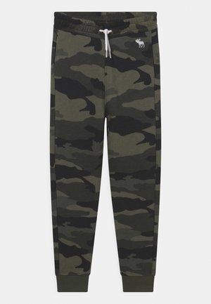 ICON - Pantalones deportivos - green