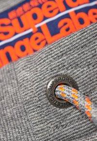 Superdry - ORANGE LABEL - Tracksuit bottoms - light grey - 3
