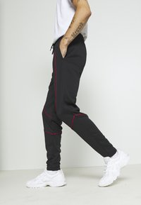 Jordan - JUMPMAN AIR SUIT PANT - Träningsbyxor - black/gym red - 3