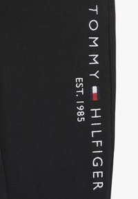 Tommy Hilfiger - ESSENTIAL - Tracksuit bottoms - black - 3