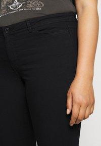 Vero Moda Curve - VMMANYA  - Slim fit jeans - black - 3