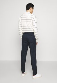 Tommy Hilfiger - TAPERED SUMMER FLEX - Trousers - blue - 2