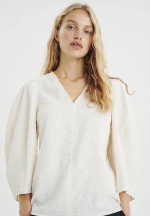 Blusa - whisper white