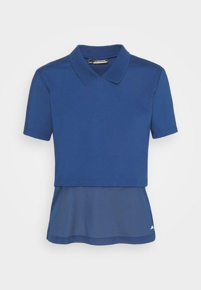 ESSI GOLF - Polo shirt - midnight blue