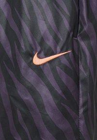 Nike Sportswear - Tracksuit bottoms - dark raisin/bright mango - 6