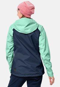 Jack Wolfskin - Waterproof jacket - dark indigo emerald green - 1