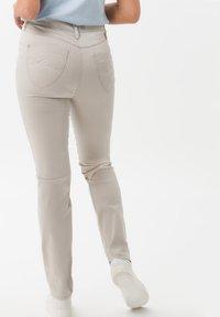 BRAX - Trousers - beige - 1