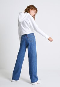 Levi's® - HIGH LOOSE - Flared jeans - blue denim - 2