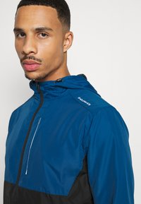 Endurance - THOROW RUNNING JACKET WITH HOOD - Sports jacket - poseidon - 4
