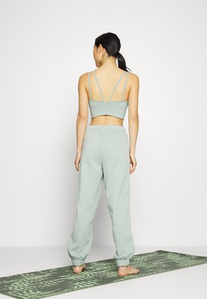 RELAXED - Tracksuit bottoms - jadeite