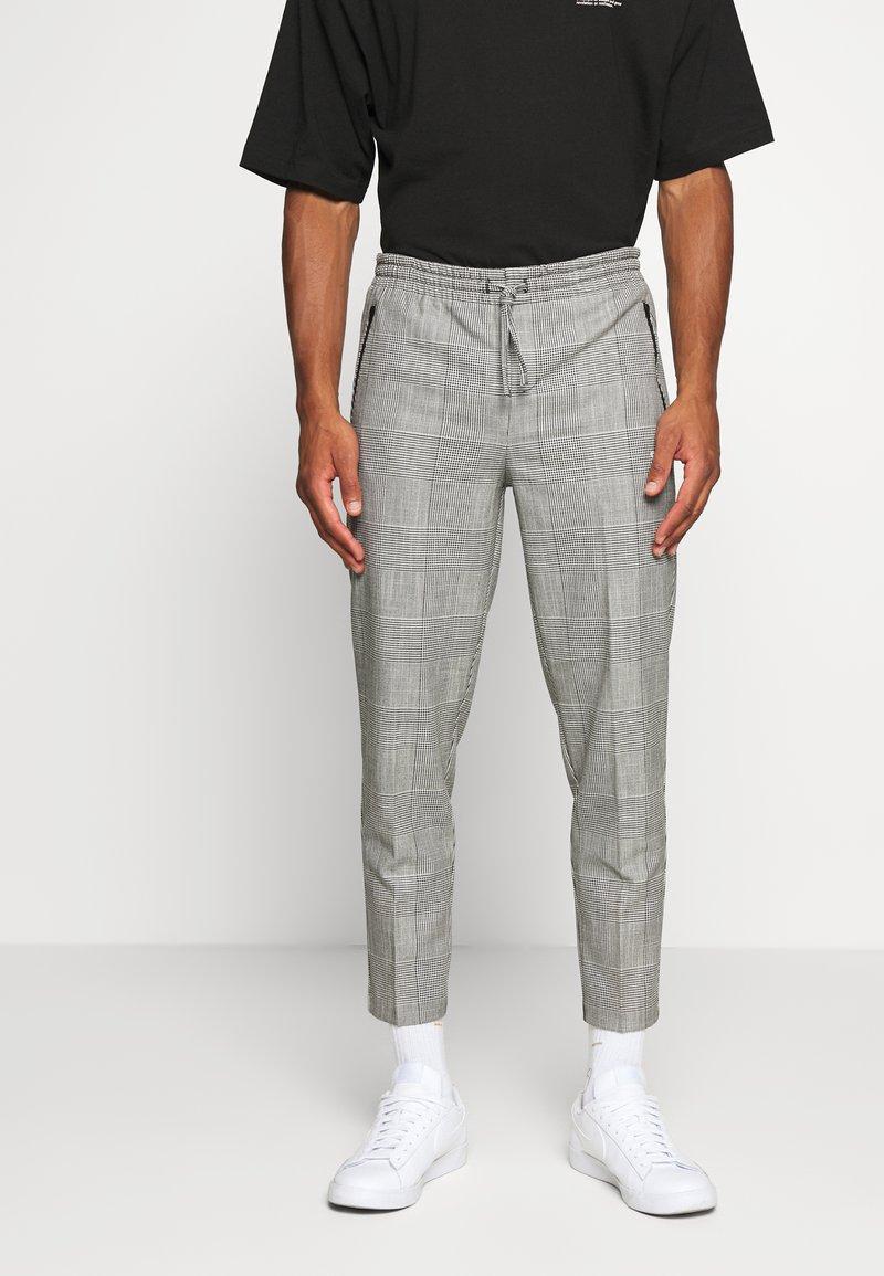 WRSTBHVR - SMART JOGGER - Kalhoty - black