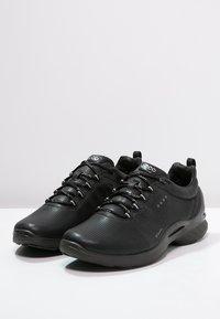 ECCO - BIOM FJUEL - Neutral running shoes - black - 2