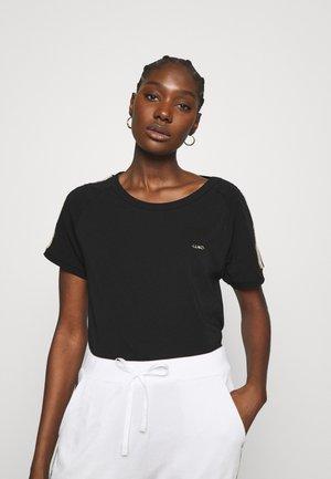 T-shirts med print - nero