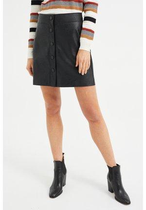 KNOOPSLUITING - Leather skirt - black