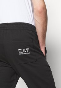 EA7 Emporio Armani - Tracksuit bottoms - black/white - 3