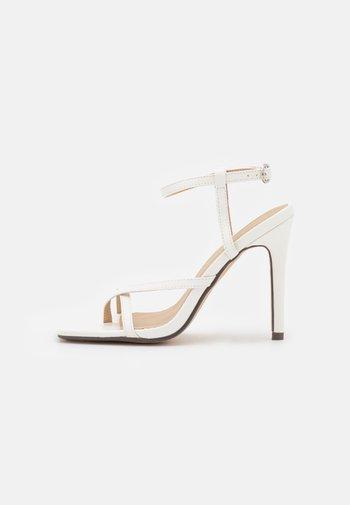 ANAIS  - T-bar sandals - white
